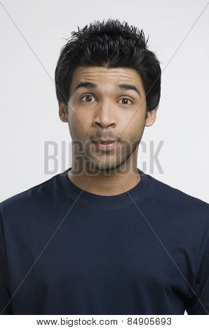 Man looking surprised with his raised eyebrows