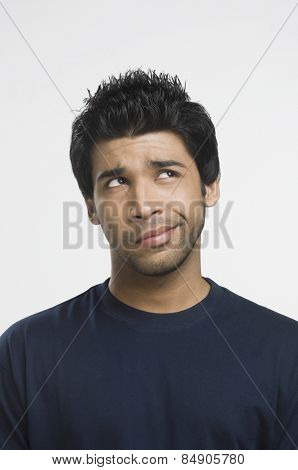 Man making a funny face and looking up