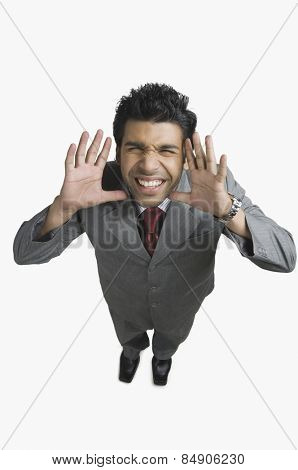 Businessman gesturing and making a funny face