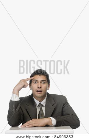 Portrait of a businessman thinking with his eyes wide open