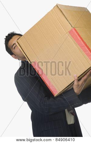 Businessman holding a cardboard box