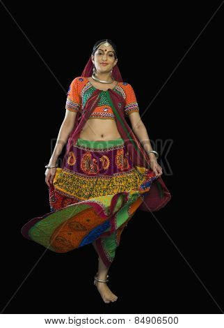 Woman in colorful lehenga choli dancing