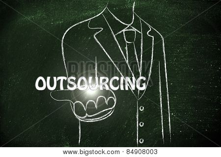 Business Man Handing Out The Word Outsourcing