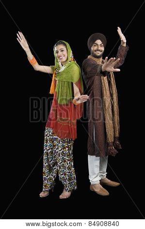 Portrait of a Sikh couple dancing