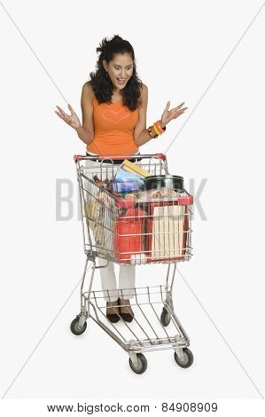 Woman looking at a shopping cart and surprised
