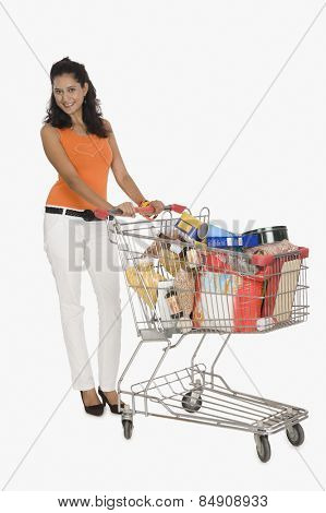 Portrait of a woman pushing a shopping cart