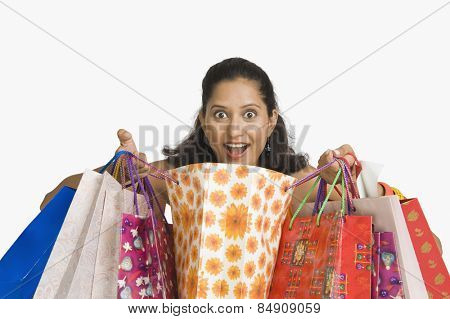 Close-up of a woman with shopping bags