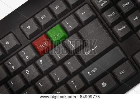 Computer keyboard with sell and buy keys