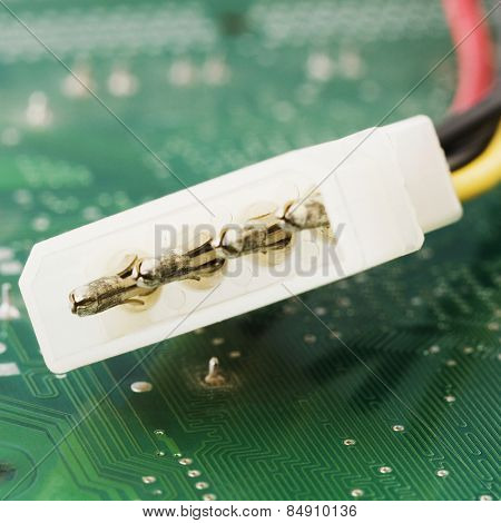Close-up of a 4pin power connector cable on a mother board