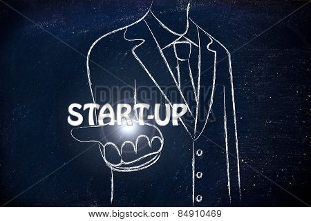 Business Man Handing Out The Word Start-up