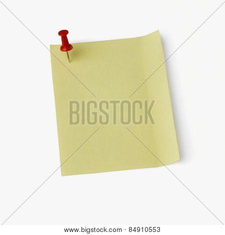 Thumbtack on an adhesive note