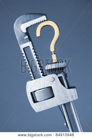 Adjustable wrench crushing question mark symbol