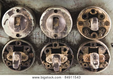 Close-up of old light-switches