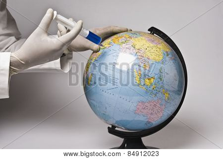 Close-up of a doctor's hand injecting a globe