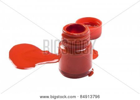 Color spilled from a red watercolor bottle