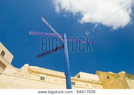 Low angle view of a directional sign, Valletta, Malta