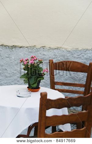 Table and chairs at a sidewalk cafe, Athens, Greece