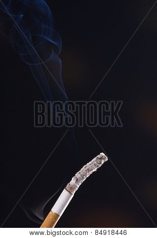 Close-up of a cigarette with ash
