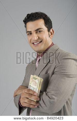 Businessman holding Indian five hundred rupee banknotes