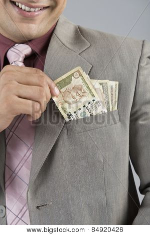 Businessman with Indian five hundred rupee banknotes in his pocket