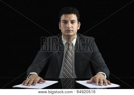 Businessman with his hands on two documents