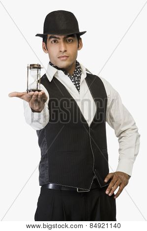 Businessman showing an hourglass