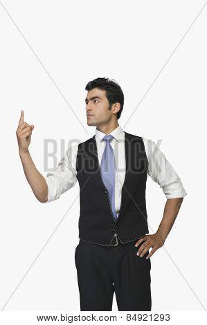 Businessman pointing upwards