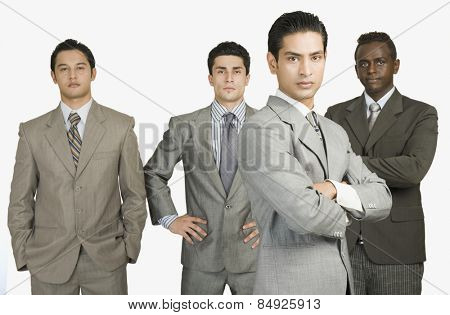 Portrait of four businessmen standing together