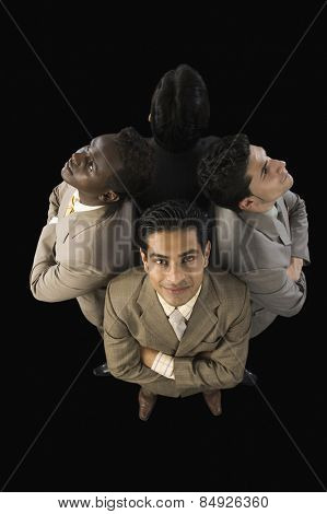 High angle view of four businessmen standing with arms crossed