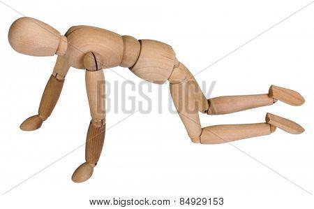 Close-up of an artist's figure crawling