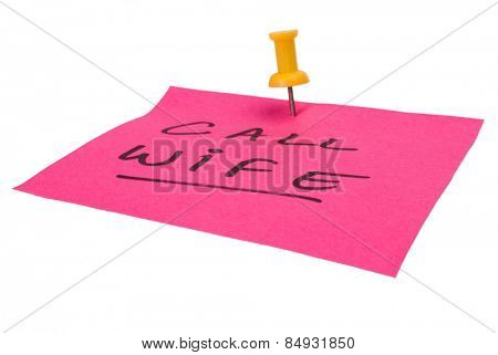 Text Call Wife written on an adhesive note