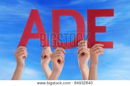 People Holding Straight German Word Ade Means Goodbye Blue Sky