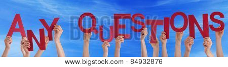 Many People Hands Holding Red Word Any Questions Blue Sky