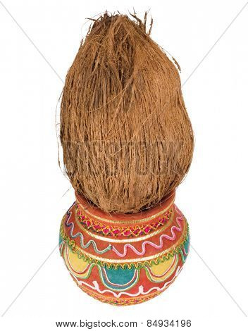 Close-up of a kalash with a coconut