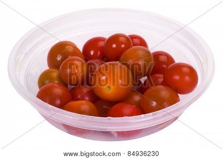 Tomatoes in a plastic bowl
