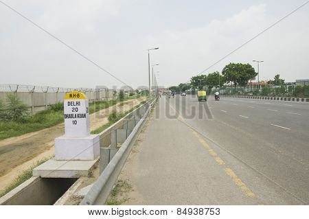 Milestone at the roadside, National Highway 8, New Delhi, India