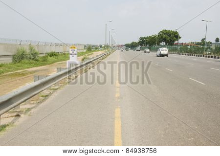 Vehicles on a highway, National Highway 8, New Delhi, India