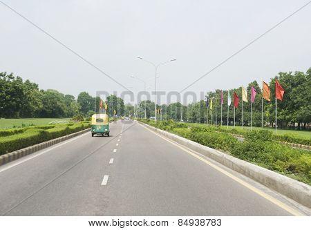 Auto rickshaw on the road, Shanti Path, New Delhi, India