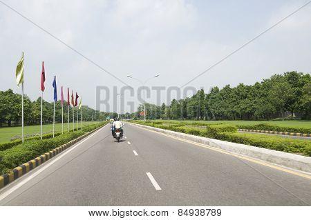 Motorcycle on the road, Shanti Path, New Delhi, India