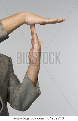 Businessman's hands making time out signal
