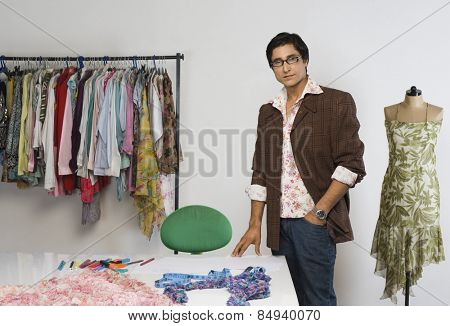 Portrait of a tailor standing in a clothing store
