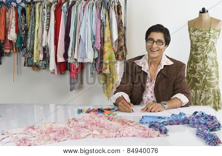 Portrait of a tailor working in a clothing store