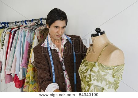 Tailor working in a clothing store