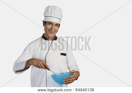 Portrait of a chef holding a mixing bowl