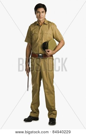 Portrait of a police officer holding a nightstick