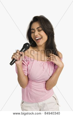 Woman singing into a microphone