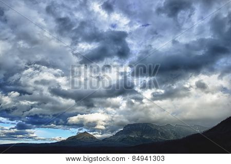Dark Clouds In The Sky And Mountains