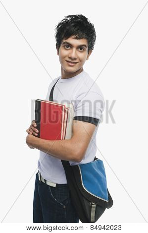 Portrait of a college student holding notebooks