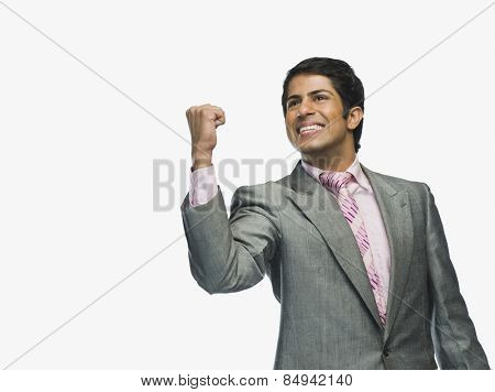 Businessman clenching fist in excitement