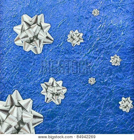 Shiny Blue Leaf Gold And  Silver Ribbon On Shiny Foil